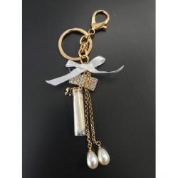 Porte clés - Pompon, noeud avec strass et perles Articles de Paris