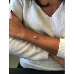 Bracelet - Cordon avec perle et pompon Articles de Paris